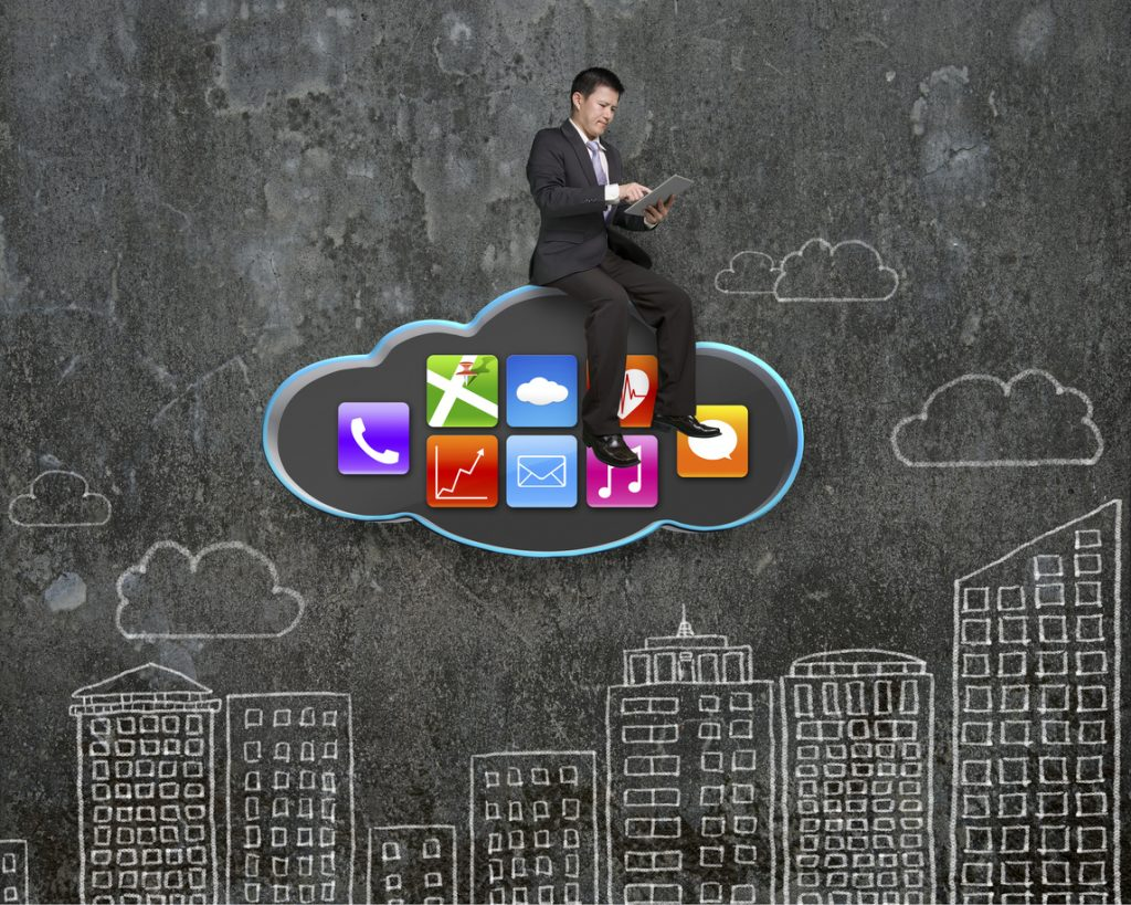 Businessman using tablet on black cloud with app icons and sky buildings doodles wall background. Doodles in this image was created via Photoshop cc by me.